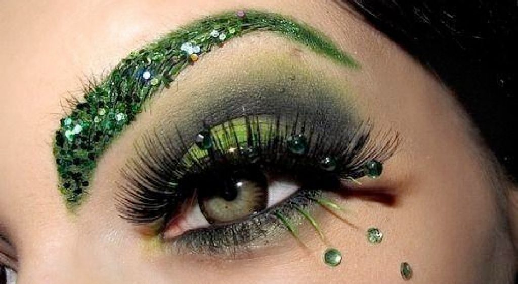 Halloween face with green glitter